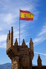Spanish flag on the Templar castle of Ponferrada, Leon, Spain