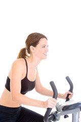 Smiling Caucasian Woman Riding Exercise Bike White Background