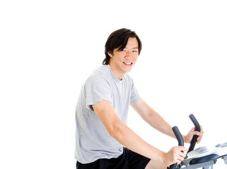Smiling Asian Man on Exercise Bike in Work Out Clothing