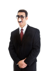 Smiling Businessman Wearing Groucho Marx Glasses Looking Camera
