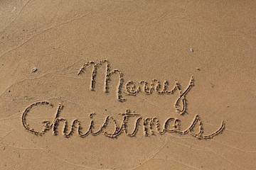 Merry Christas written in sand