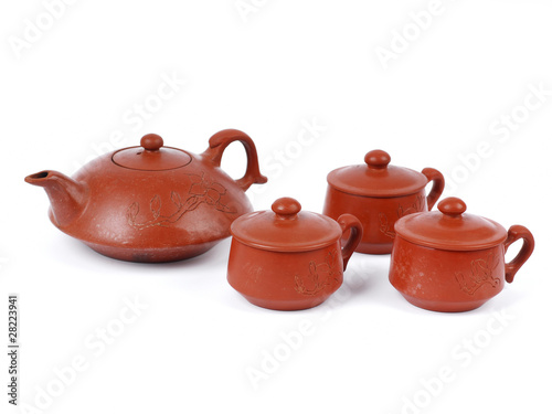 China tradicional brown tea pot and tea cups . isolated on white