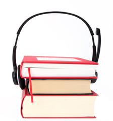 Concept of audio books, headphones and books on white