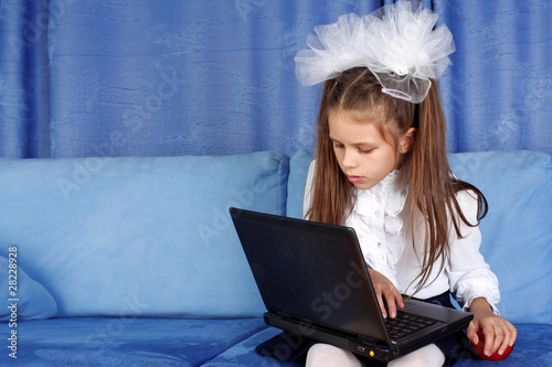 hard day in learning - girl with laptop and red apple in sofa