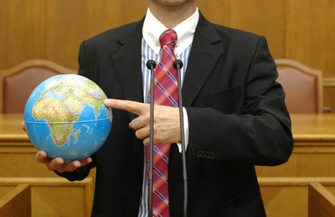 politician holding the planet Earth , global pollution concept