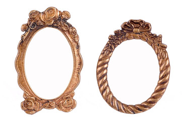 Gold plated and richly decorated frames on a white background