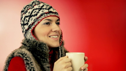 Winter woman holding mug with hot drink