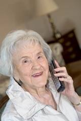 Elderly Woman on Phone Smiling