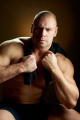 Muscular man, contrasty studio portrait