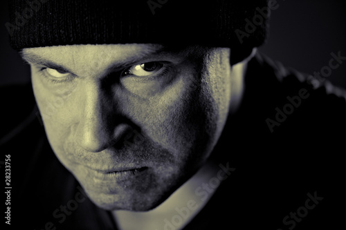 Closeup portrait of a serious man in hat