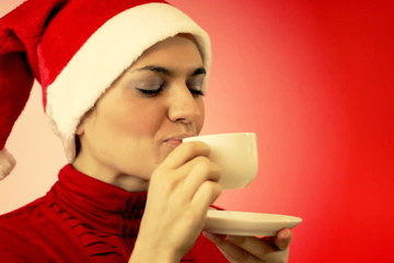 Christmas woman with cup of tea
