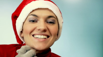 Curious young woman in santa hat