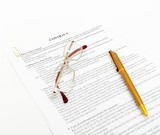 legal contract with pen and glasses