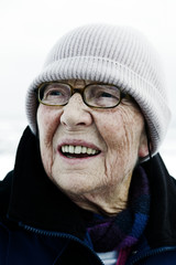 old woman with glasses and cap