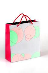 Bolsa de colores en fondo blanco, paquete, tienda