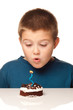 Young boy deciding to eat a dessert