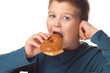 Young boy deciding to eat a donut