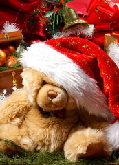 A cute little teddy bear in a Christmas hat