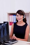 Customer care  executive  interacting using  headset poster