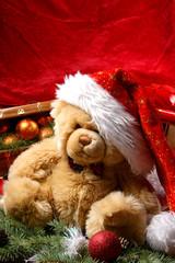 A cute little teddy bear in a Christmas hat