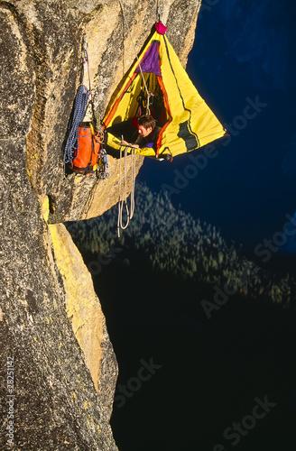 Rock climber bivouaced in a portaledge.