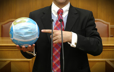 politician holding the planet Earth