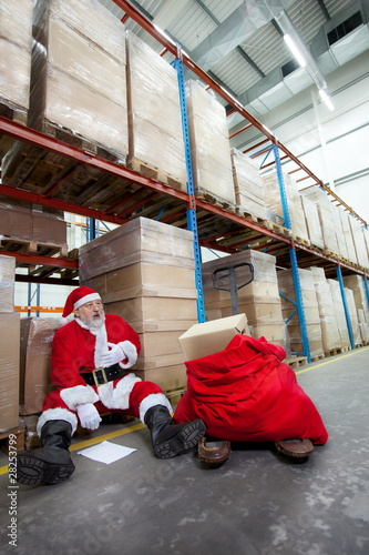 Overworked santa claus with pain in chest