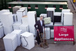 A businessman standing with a trolley in a recycling center
