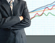 Businessman in front of graph