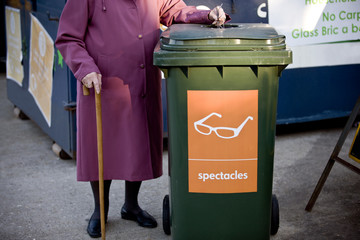 A senior woman recycling spectacles