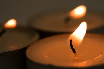 Macro of three burning candles