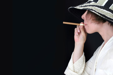 Woman in hat with cigar (retro style)