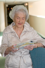 Elderly Woman opening Mail
