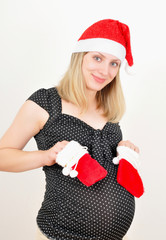 pretty pregnant woman in santa claus hat