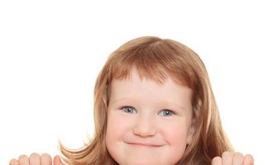 Cute little girl leaning on a billboard