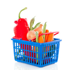fresh vegetables in a plastic shopping basket isolated over whit