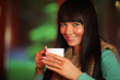 Happy beautiful woman drinking hot tea, closeup