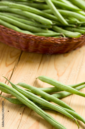 bean pods on wooden table