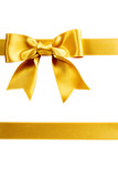 Fototapety single gift bow, golden satin, with two ribbons on white