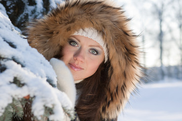 .Young woman in winter wood.