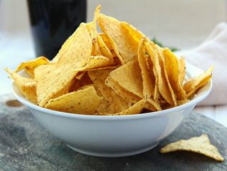 Mexican corn chips in a white cup