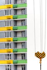 Crane hook over building