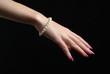 wrist with a pearl bracelet - 28293373