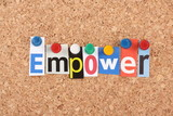 The word Empower in magazine letters on a notice board poster