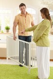 Couple deciding on baby bed poster