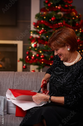 Senior woman wrapping christmas presents
