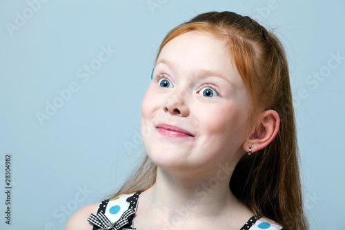 Portrait of surprised red-haired girl