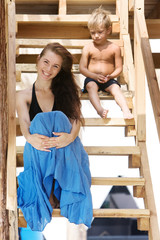 mother and son on wooden steps