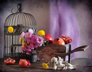 still life with a cage and grenades