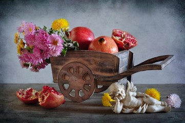 still life with flowers and pomegranate